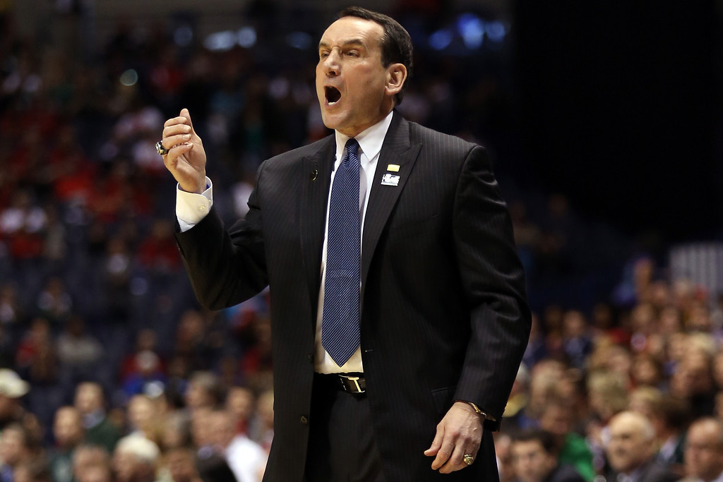 . INDIANAPOLIS, IN - MARCH 29:  Head coach Mike Krzyzewski of the Duke Blue Devils reacts in the first half against the Michigan State Spartans during the Midwest Region Semifinal round of the 2013 NCAA Men\'s Basketball Tournament at Lucas Oil Stadium on March 29, 2013 in Indianapolis, Indiana.  (Photo by Andy Lyons/Getty Images)