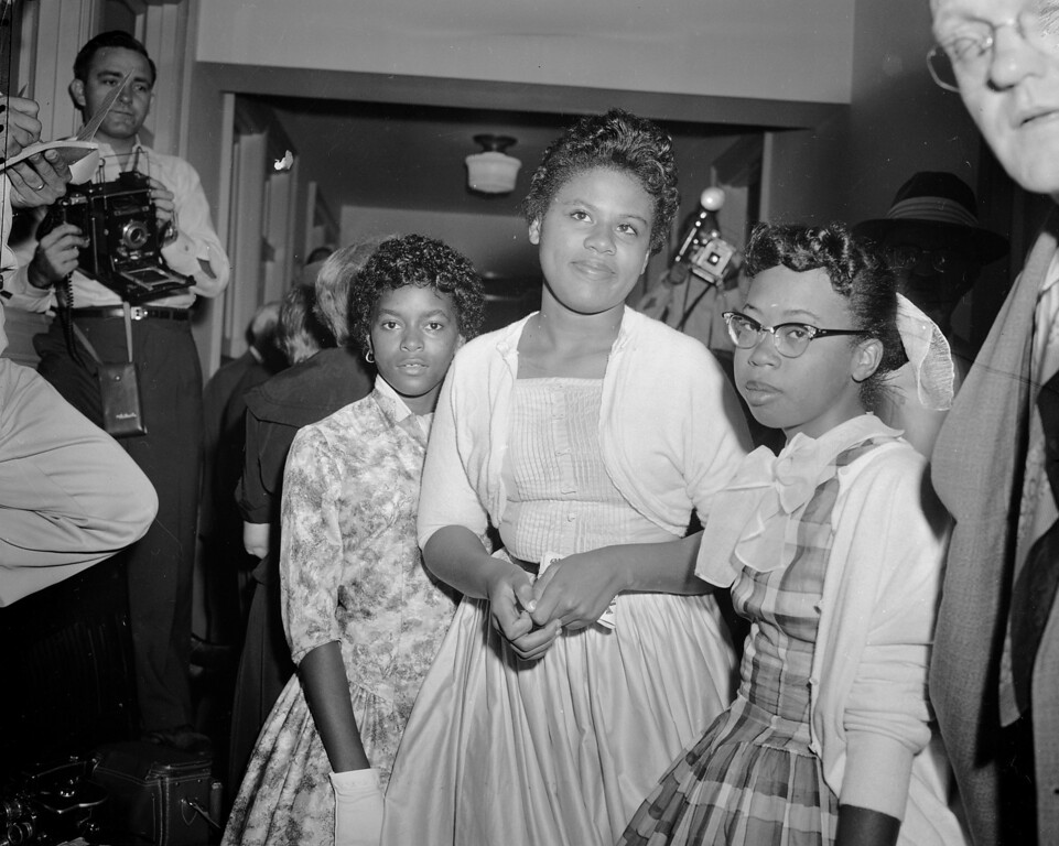 . Left to right:  Dorothy Frazier, 13, Minnie Brown, 15, and Thelma Mothershed, 16, wait in a corridor of the U.S. Courthouse at Little Rock, Ark., where they were called to testifiy at a hearing on the integration problems at Central High School, Sept. 7, 1957.  Thelma and Minnie were two of the students who were turned away by the National Guard as they attempted to enter the building on the first day of school.  (AP Photo/William P. Straeter)