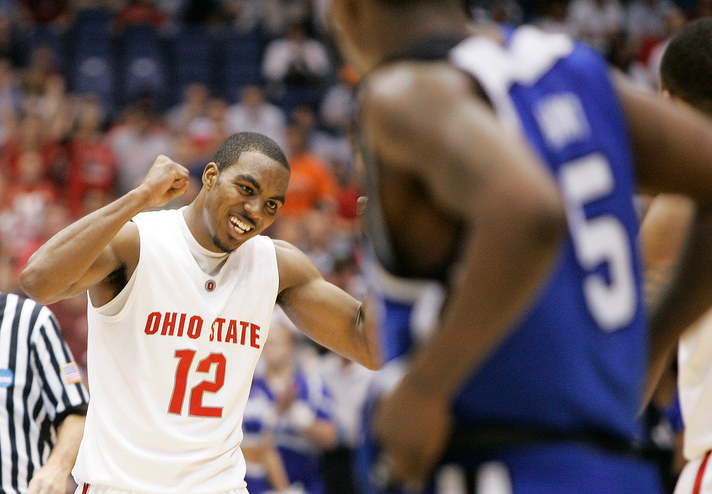. Ohio State guard Ron Lewis (12) reacts at the end of a 92-76 win over Memphis in their NCAA South Regional final basketball game at the Alamodome in San Antonio Saturday, March 24, 2007.  (AP Photo/David J. Phillip)