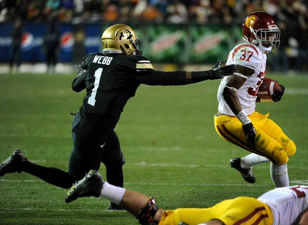 . BOULDER, CO - NOVEMBER 23: Senior Derrick Webb (1), a linebacker for the Colorado Buffaloes football team, makes a move on USC\'s Javorius Allen in the game against the Southern California Trojans at Folsom Field in mid-November. (Photo by Kathryn Scott Osler/The Denver Post)