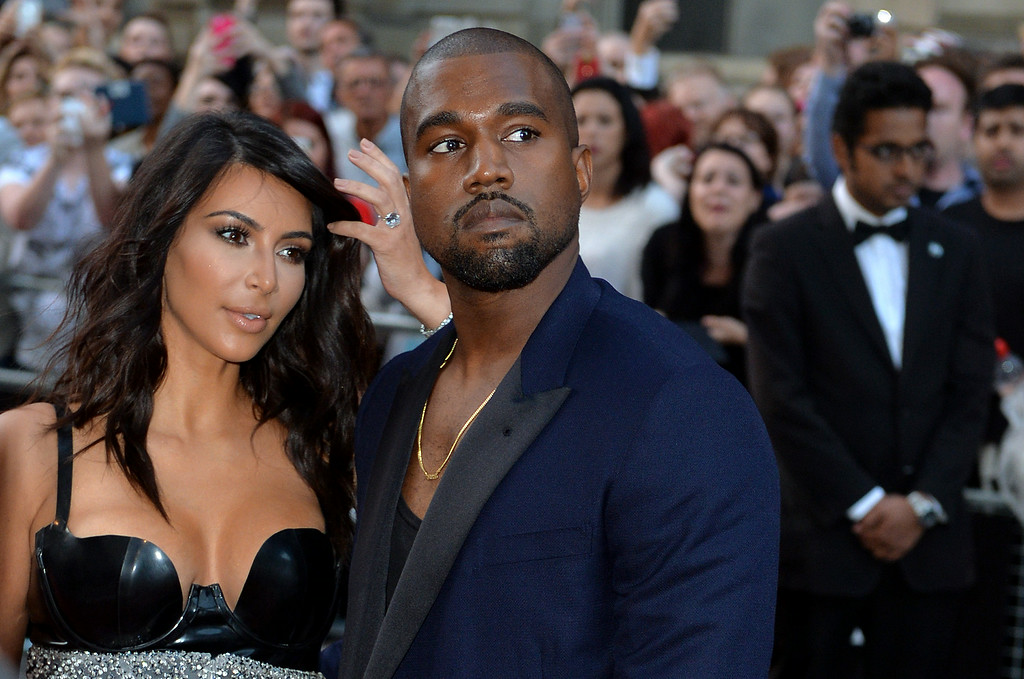 . Kim Kardashian and Kanye West attend the GQ Men of the Year awards at The Royal Opera House on September 2, 2014 in London, England.  (Photo by Anthony Harvey/Getty Images)