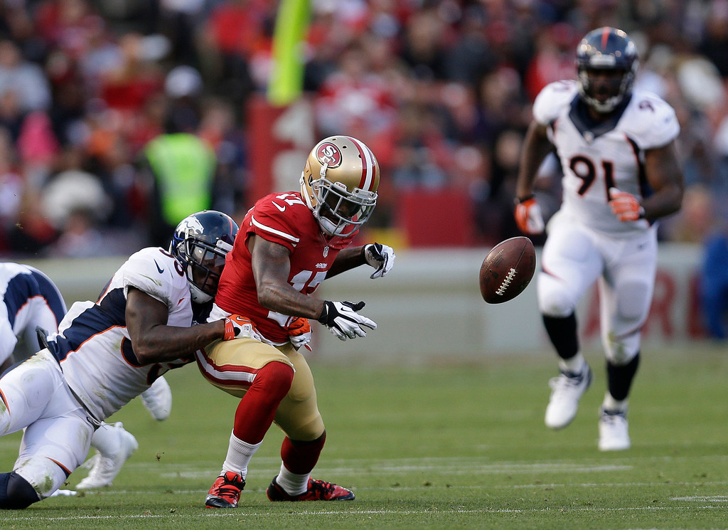 . San Francisco 49ers wide receiver A.J. Jenkins, center, fumbles the ball as Denver Broncos safety Duke Ihenacho, left, makes a tackle and Broncos defensive end Robert Ayers (91) looks on during the second quarter of an NFL preseason football game on Thursday, Aug. 8, 2013, in San Francisco. (AP Photo/Marcio Jose Sanchez)