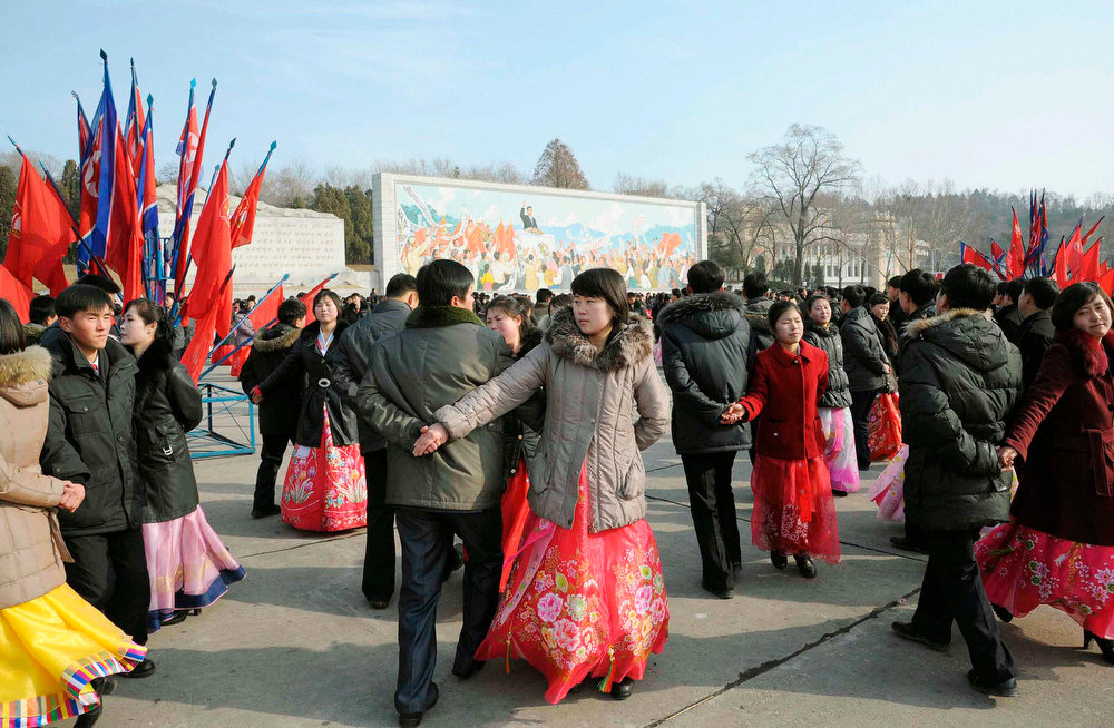 Description of . North Koreans dance to celebrate the birthday of their late leader Kim Jong-il in Pyongyang, in this photo taken and provided by Kyodo February 16, 2013. REUTERS/Kyodo