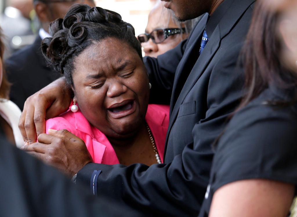 . Brandalyn Johnson, the guardian who raised 6-year-old Ahlittia North, whom the child referred to as her mother, cries at the conclusion of Ahlittia\'s funeral in Gonzales, La., Monday, July 22, 2013. Ahlittia was stabbed to death after disappearing from her mother\'s suburban New Orleans apartment more than a week ago. Her body was found days later. (AP Photo/Gerald Herbert)