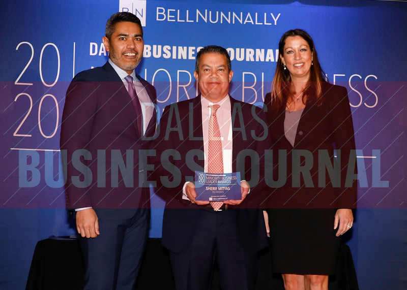Sherif Mityas, Chief Experience Officer, TGI Fridays, (center) accepts his Minority Business Leader award from Chandhok, (left) and Mathes.