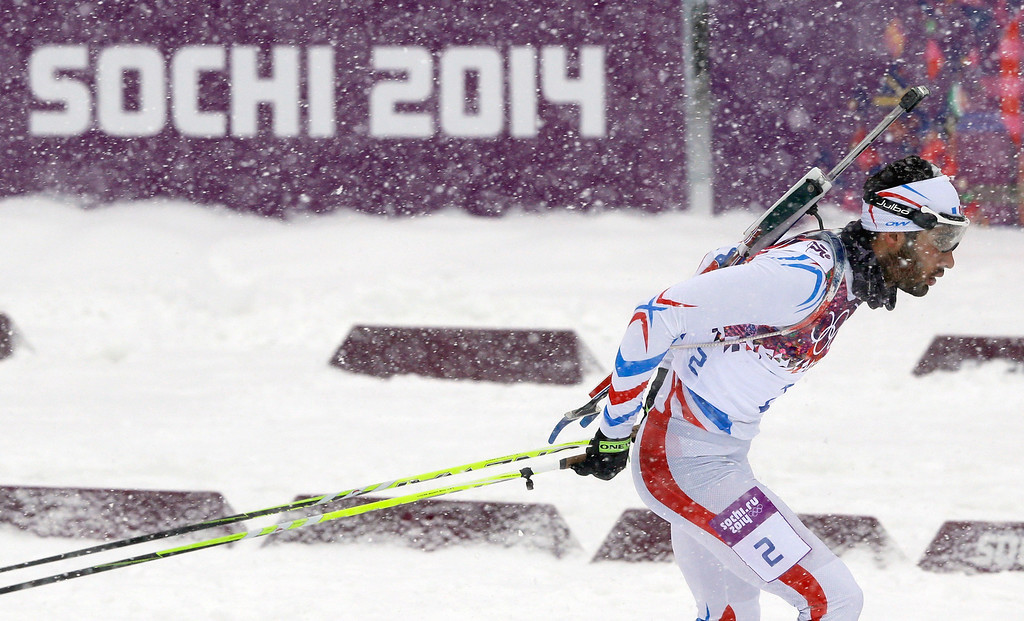 . France\'s Martin Fourcade competes during the men\'s biathlon 15k mass-start, at the 2014 Winter Olympics, Tuesday, Feb. 18, 2014, in Krasnaya Polyana, Russia. (AP Photo/Kirsty Wigglesworth)