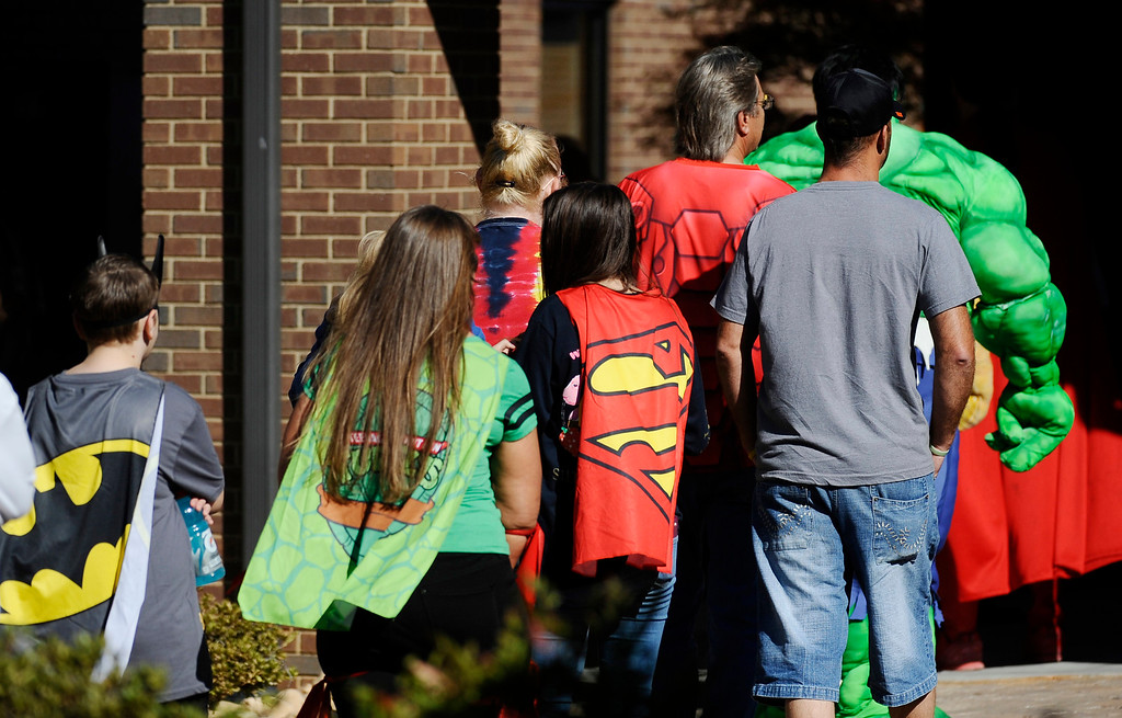 . Friends and family arrive before a superhero-themed funeral service for Jacob Hall at Oakdale Baptist Church on Wednesday, Oct. 5, 2016, in Townville, S.C.   Jacob\'s family has encouraged people to celebrate his life by dressing as the superheroes he loved.  A 14-year-old boy killed his own father, then drove to Townville Elementary and fired on two children and a teacher as recess began.  Jacob died Saturday.(AP Photo/Rainier Ehrhardt)