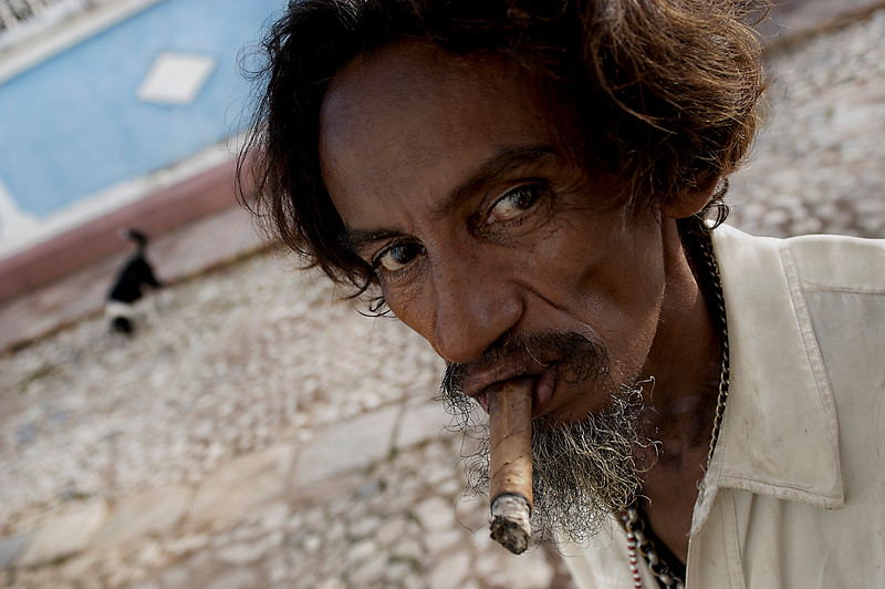 The famous Romeo y Julieta Cuban cigar is said to have been Winston Churchill's favorite. This underprivileged man on the street settles for a home made version.   Trinidad, Cuba, 2006