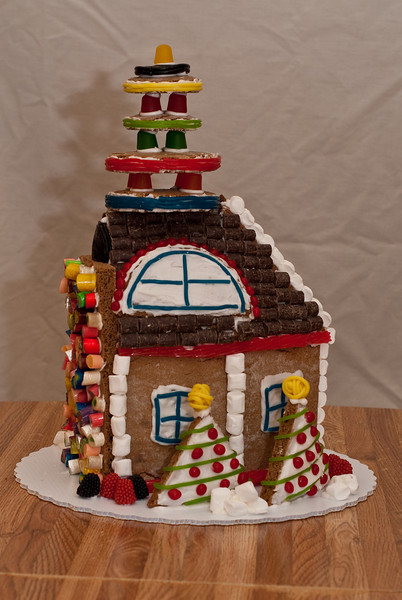 Gingerbread house left side view.  You can see the dimensional rift slowing consuming the back of the house.  (Ab Initio, Joel's company, gave everyone a gingerbread house building kit.  Here is the house Daphne and Ben built.)