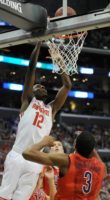 . Ohio State #12 Sam Thompson drives to the hoop against Arizona #3 Kevin Parrom in the first half. Arizona and Ohio State met at Staples Center for the West Regional of the NCAA Division I Men\'s Basketball Championships. Los Angeles,CA 3/28/2013(John McCoy/Staff Photographer