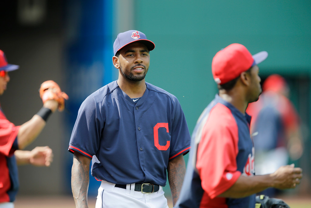 . Cleveland Cavaliers\' Kyrie Irving warms up before taking batting practice with the Cleveland Indians prior to a baseball game against the Los Angeles Angels Monday, June 16, 2014, in Cleveland. (AP Photo/Mark Duncan)
