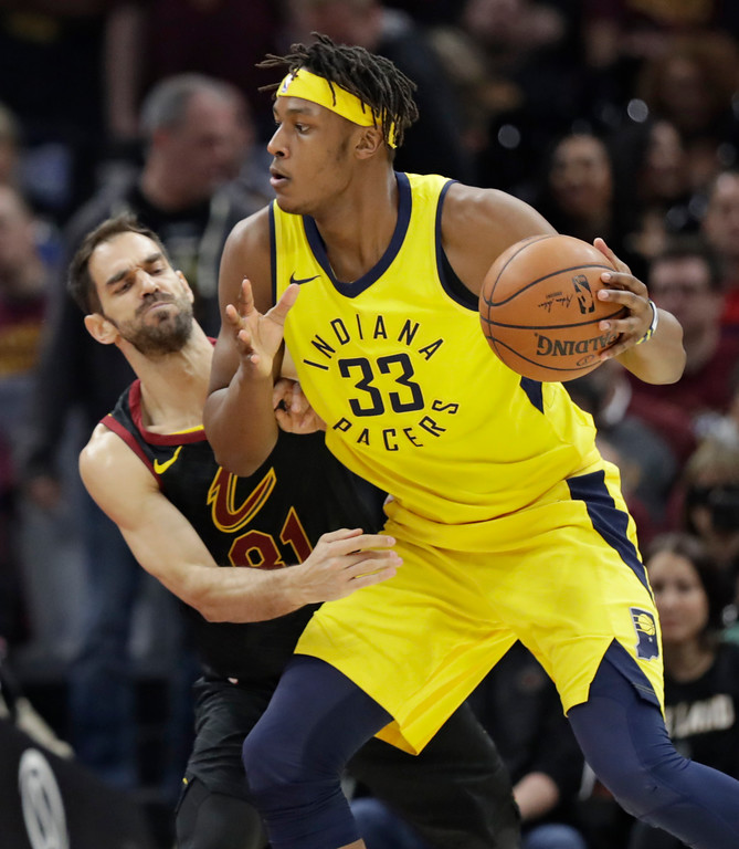 . Indiana Pacers\' Myles Turner (33) drives against Cleveland Cavaliers\' Jose Calderon (81), from Spain, in the first half of Game 5 of an NBA basketball first-round playoff series, Wednesday, April 25, 2018, in Cleveland. (AP Photo/Tony Dejak)