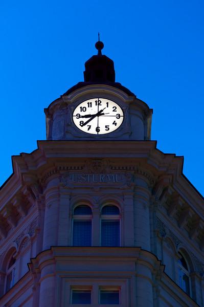 Clock on top of a building in Prague, Czech Republic