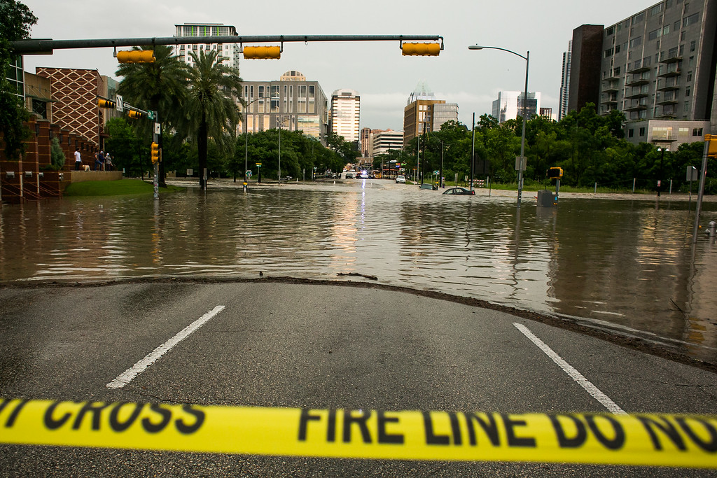 . AUSTIN, TX - MAY 25:   Parts of the city are shown inundated after days of heavy rain on May 25, 2015 in Austin, Texas. Texas Gov. Greg Abbott toured the damage zone where one person is confirmed dead and at least 12 others missing in flooding along the Rio Blanco, which reports say rose as much as 40 feet in places, caused by more than 10 inches of rain over a four-day period. The governor earlier declared a state of emergency in 24 Texas counties.  (Photo by Drew Anthony Smith/Getty Images)
