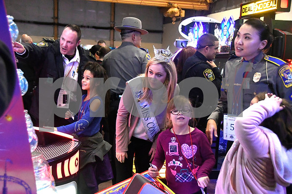 12/7/2017 Mike Orazzi | Staff Miss Connecticut 2017 Eliza Kanner during a meet and greet held at Crystal Bees in Southington before shopping for Shop with a Cop, a one on one shopping experience pairing underprivileged children with law enforcement.