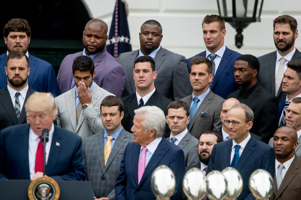 . President Donald Trump, left, accompanied by New England Patriots owner Robert Kraft, bottom center, New England Patriots president Jonathan Kraft, bottom right and New England Patriots players including tight end Rob Gronkowski, top second from right, speaks at a ceremony on the South Lawn of the White House in Washington, Wednesday, April 19, 2017, where the president honored the Super Bowl Champion New England Patriots for their Super Bowl LI victory. (AP Photo/Andrew Harnik)