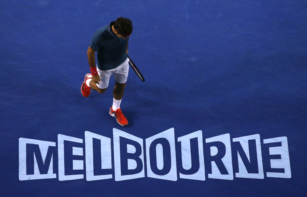 . Roger Federer of Switzerland walks not he court between points as he plays Rafael Nadal of Spain during their semifinal at the Australian Open tennis championship in Melbourne, Australia, Friday, Jan. 24, 2014.(AP Photo/Eugene Hoshiko)