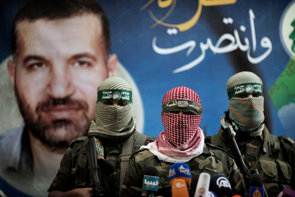. Members of the Ezzedine al-Qassam Brigades, the armed wing of Hamas, address a press conference in Gaza City on November 22, 2012 at the house of their late leader Ahmed Jaabari, who was killed when an Israeli air strike hit his car on November 14. Israeli politicians returned to the campaign trail as the streets of Gaza came back to life after a truce ended eight days of bloodshed, with both sides claiming victory while remaining wary. MARCO LONGARI/AFP/Getty Images