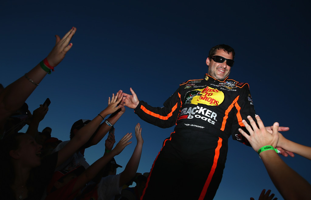 . DAYTONA BEACH, FL - JULY 06:  Tony Stewart, driver of the #14 Bass Pro Shops / Ducks Unlimited Chevrolet, greets fans during driver introductions during the NASCAR Sprint Cup Series Coke Zero 400 at Daytona International Speedway on July 6, 2013 in Daytona Beach, Florida.  (Photo by Tom Pennington/Getty Images)
