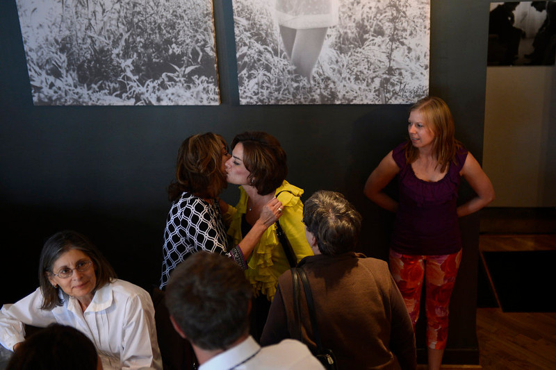 . Tammy Cunningham, owner of Strings Restaurant is kissed by former employee Tina Martelon on the last day of service April 30, 2013 Denver, Colorado. (Photo By Joe Amon/The Denver Post)
