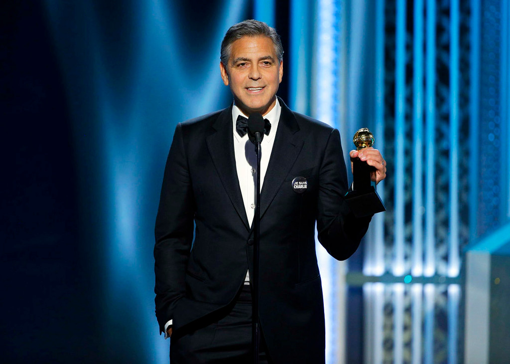 . In this image released by NBC, George Clooney accepts the Cecil B. DeMille Award at the 72nd Annual Golden Globe Awards on Sunday, Jan. 11, 2015, at the Beverly Hilton Hotel in Beverly Hills, Calif. (AP Photo/NBC, Paul Drinkwater)