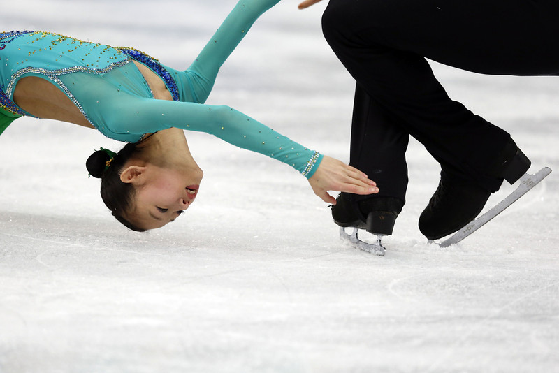. China\'s Zhang Hao and China\'s Peng Cheng perform during the Figure Skating Pairs Team Short Program at the Iceberg Skating Palace during the Sochi Winter Olympics on February 6, 2014.  (ADRIAN DENNIS/AFP/Getty Images)