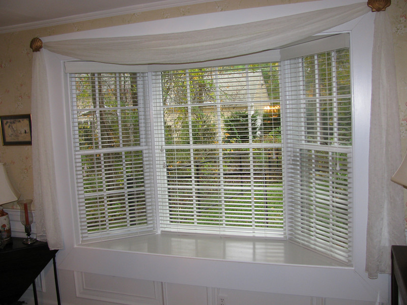 "1 3/8"" Country Wood Blinds in bay window, tilted open"