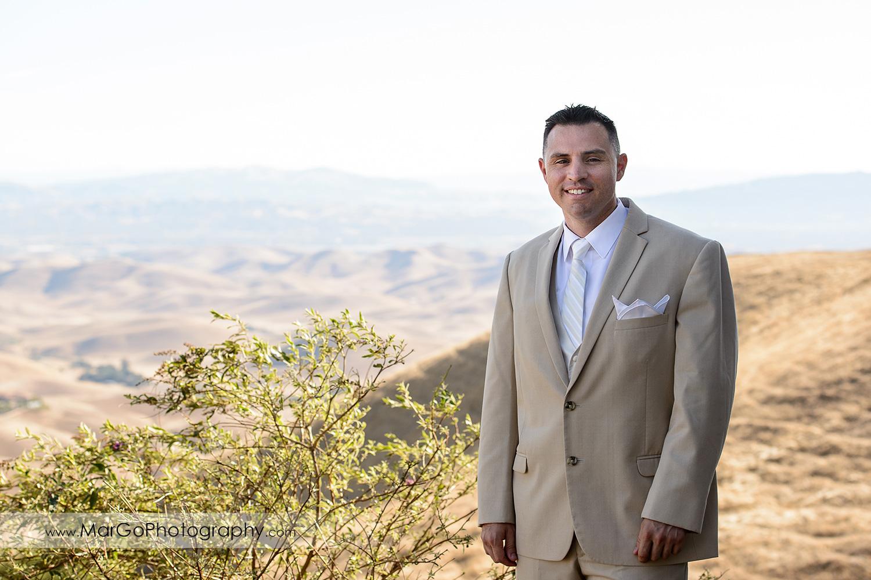 portrait of the groom in light suit