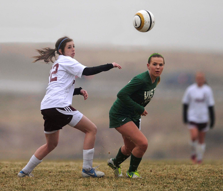 . Mustangs defender Gracie Tynecki (22) challenged Golden Eagles forward Maddy Smith (12) for the ball in the second half. The Mountain Vista High School girl\'s soccer team defeated Ponderosa 6-0 Tuesday night, April 2, 2013.  Photo By Karl Gehring/The Denver Post)