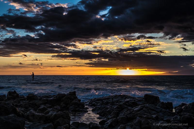 Maui paddle boarder at sunset