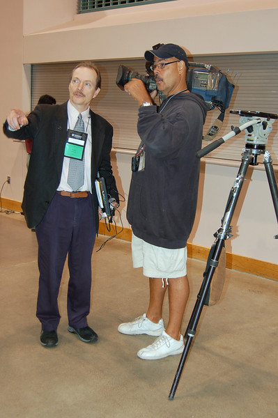 Frank Imhoff, associate director, ELCA News Service directs a local camera man.
