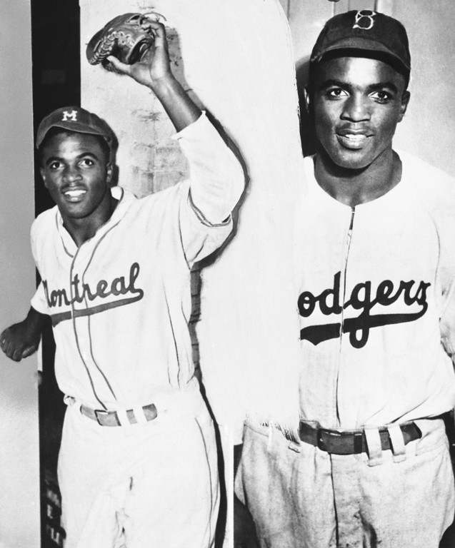 . Jackie Robinson shown April 11, 1947 in Montreal uniform on left and Brooklyn Dodgers uniform. (AP Photo)