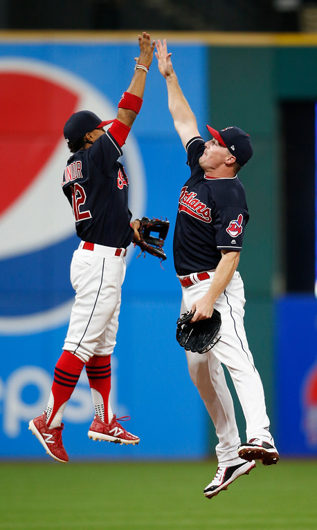 . Cleveland Indians\' Francisco Lindor, left, and Jay Bruce celebrate a 2-0 victory over the Detroit Tigers in a baseball game, Tuesday, Sept. 12, 2017, in Cleveland. (AP Photo/Ron Schwane)