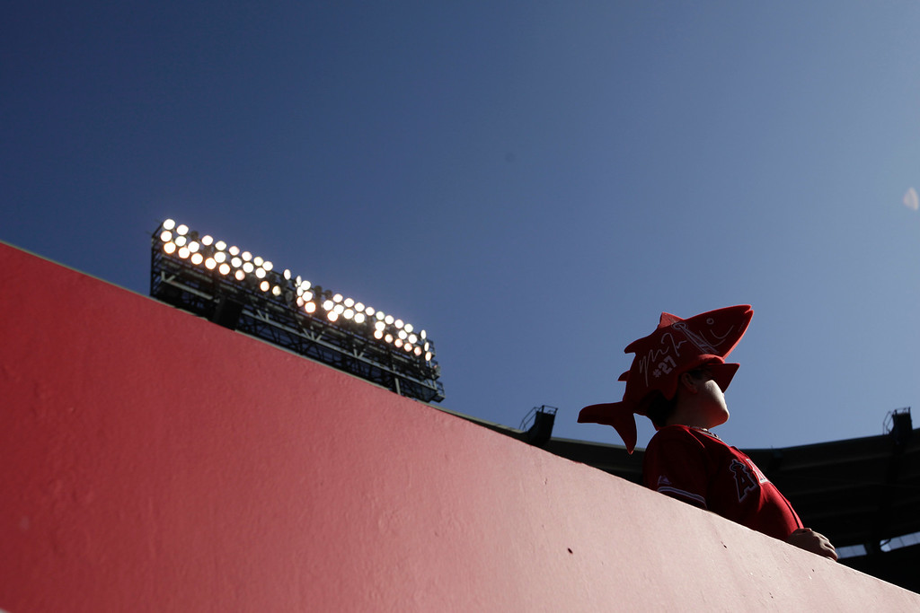 . A baseball fan wearing a Los Angeles Angels\' Mike Trout hat looks on before a baseball game between the Los Angeles Angels and the Seattle Mariners in Anaheim, Calif., Tuesday, June 18, 2013. (AP Photo/Jae C. Hong)