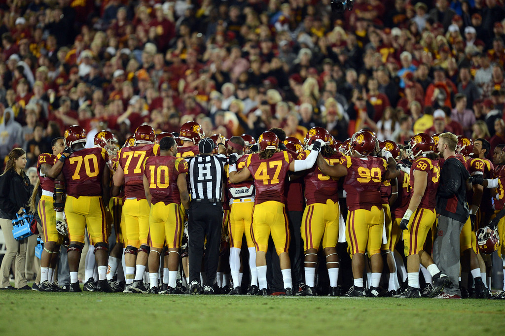 . The entire USC team huddles on the field late in the fourth quarter during their game against Stanford at the Los Angeles Memorial Coliseum Saturday, November 16, 2013. USC beat Stanford 20-17. (Photos by Hans Gutknecht/Los Angeles Daily News)