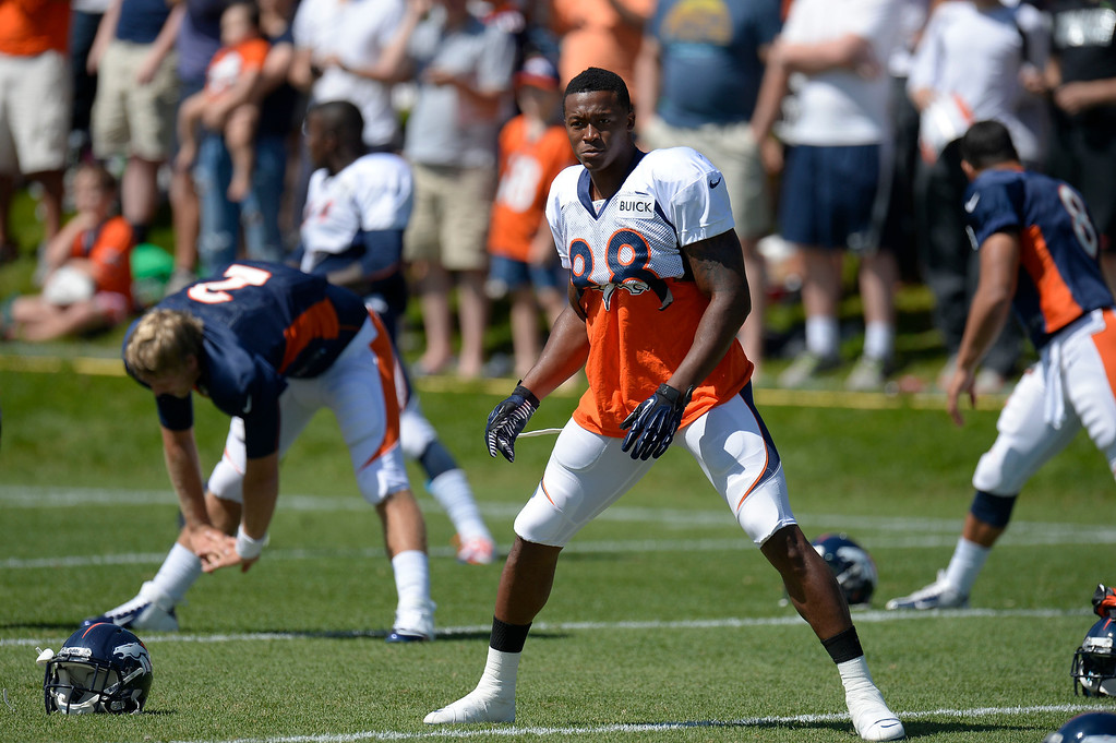 . Denver Broncos WR Demaryius Thomas (88) stretches during training camp August 5, 2013 at Dove Valley. (Photo By John Leyba/The Denver Post)