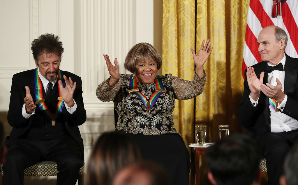 . The recipients of the 2016 Kennedy Center Honors, actor Al Pacino and musician James Taylor, applaud gospel and blues singer Mavis Staples as she is recognized, during a reception in their honor in the East Room of the White House in Washington, Sunday, Dec. 4, 2016, hosted by President Barack Obama and first lady Michelle Obama. (AP Photo/Manuel Balce Ceneta)