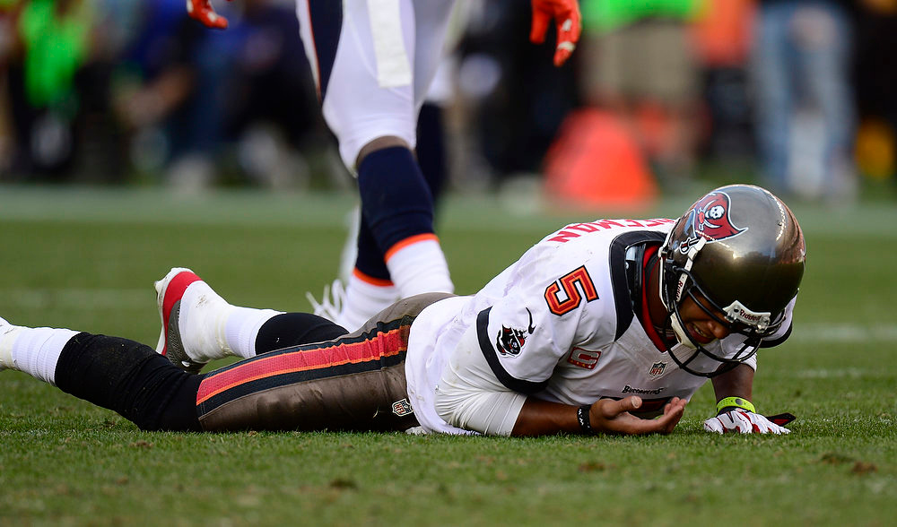 . Tampa Bay Buccaneers quarterback Josh Freeman #5 on the turf after being hit during the second quarter The Denver Broncos vs The Tampa Bay Buccaneers at Sports Authority Field Sunday December 2, 2012. Joe Amon, The Denver Post