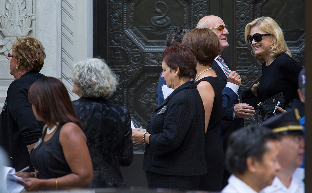 . Television news anchor Diane Sawyer, upper right, arrives at a funeral service for comedian Joan Rivers at Temple Emanu-El in New York, Sunday, Sept. 7, 2014. Rivers died Thursday, Sept. 4, 2014. She was 81. (AP Photo/Craig Ruttle)