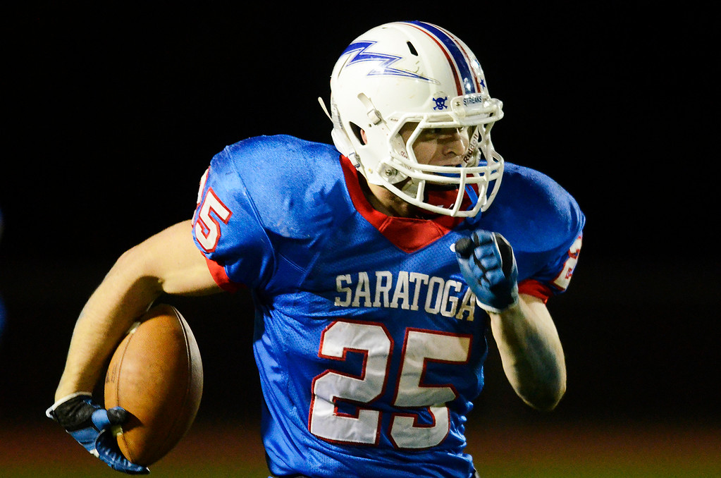 . Erica Miller - The Saratogian @togianphotog      Saratoga\'s Dakota Harvey with the third touchdown after an interception during their playoff football game against LaSalle on Friday evening under the lights in Saratoga. SAR-l-SarFootball1