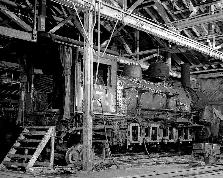 December 1961. Looks to me like 473 is getting a pretty thorough boiler and running gear overhaul. In the background you can see the narrow gauge business car stored inside the shop still in its Pullman green paint. The Alamosa backshop was a far cry from the more modern railroad backshops with their high ceilings and big overhead cranes, it looked little changed from the 1880's when it was built.