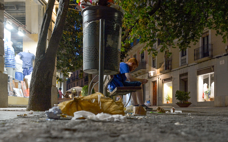 This photo was taken after a day-long festival in Girona, France. Most of the trash cans were overflowing and garbage had spilled all over the ground. I imagine Elliott being conflicted at this point. There is almost certainly food here and the brown bag could be a good place to hide but the young man is awfully close and might be a threat. What to do?