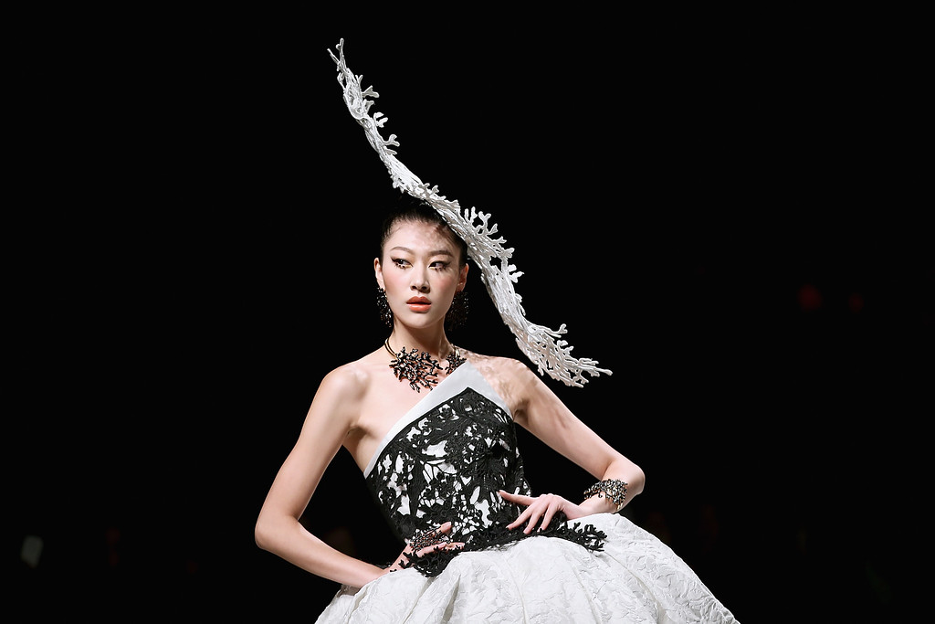 . A model showcases designs on the runway at SEC Qi Gang Collection show during Mercedes-Benz China Fashion Week Spring/Summer 2015 at Beijing Hotel on October 29, 2014 in Beijing, China.  (Photo by Feng Li/Getty Images)