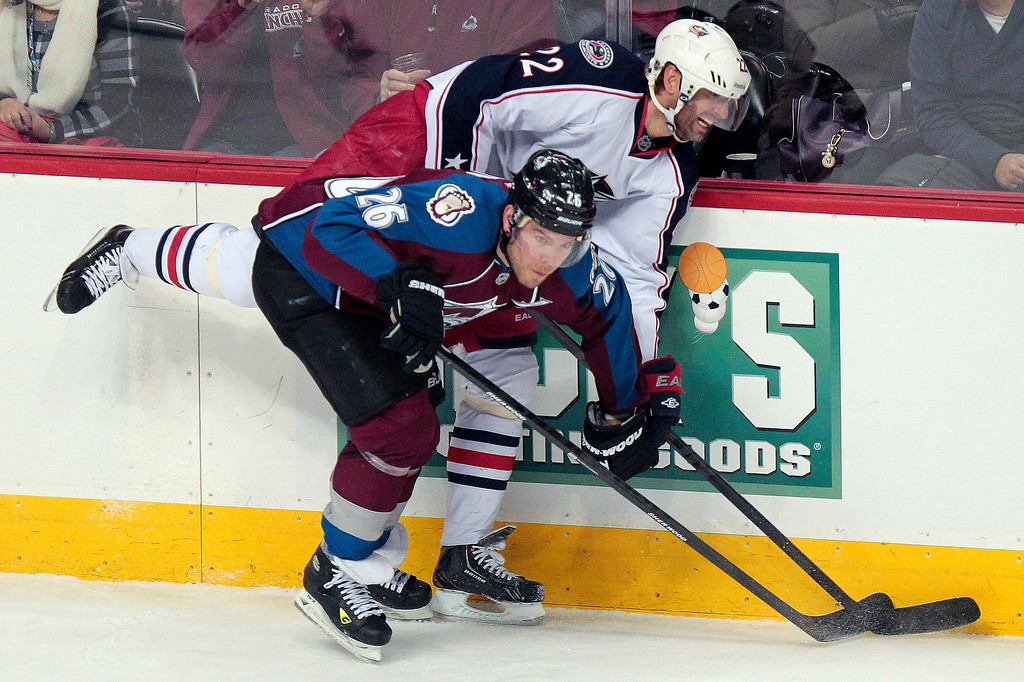 . Colorado Avalanche\'s Paul Stastny (26) checks Columbus Blue Jackets\' Vinny Prospal (22) during the first period of an NHL hockey game on Monday, April 15, 2013 in Denver. (AP Photo/Barry Gutierrez)