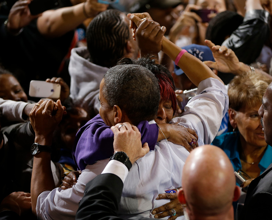 . President Barack Obama embraces a supporter during a campaign event at Doolittle Park, Wednesday, Oct. 24, 2012, in Las Vegas. (AP Photo/Pablo Martinez Monsivais)