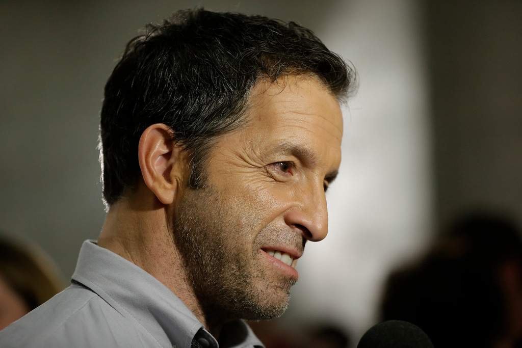 . Designer Kenneth Cole considers a reporters question before the presentation of the Kenneth Cole Fall 2013 fashion collection during Fashion Week in New York, Thursday, Feb. 7, 2013.  (AP Photo/Kathy Willens)