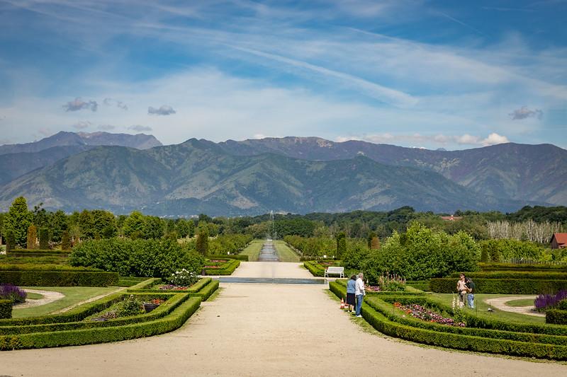 sprawling green gardens with wide walking path