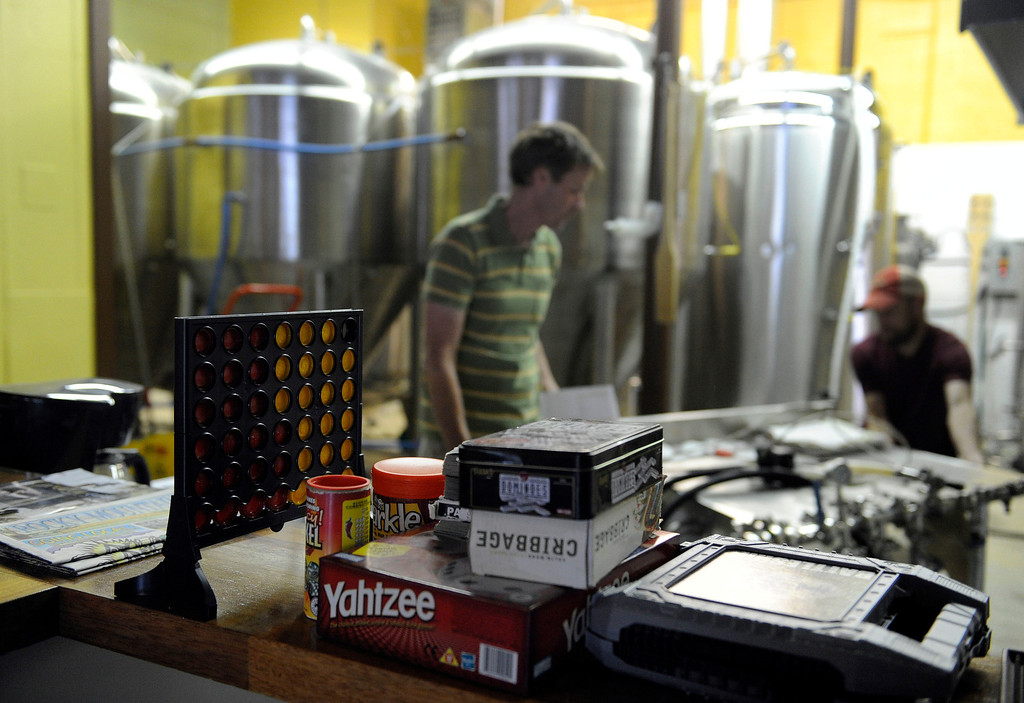 . GOLDEN, CO - AUGUST 23: Board games wait on the counter beside the brewing tanks at Mountain Toad Brewing on August 23, 2013, in Golden, Colorado. (Photo by Anya Semenoff/YourHub)