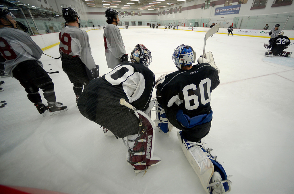 . Colorado Avalanche goalies Sami Aittokallio (30 and S[encer Martin (60) chat during a a break in practice. No. 1 draft pick Nathan MacKinnon took the ice on the first day of Avalanche rookie camp September 8, 2013 at Family Sports. (Photo by John Leyba/The Denver Post)