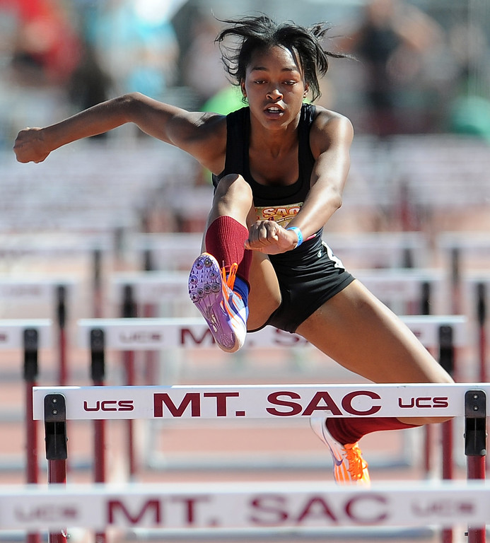 . Skylin Harbin of Alemany competes in the 100 meter hurdles invitational high school during the Mt. SAC Relays in Hilmer Lodge Stadium on the campus of Mt. San Antonio College on Saturday, April 20, 2012 in Walnut, Calif.    (Keith Birmingham/Pasadena Star-News)